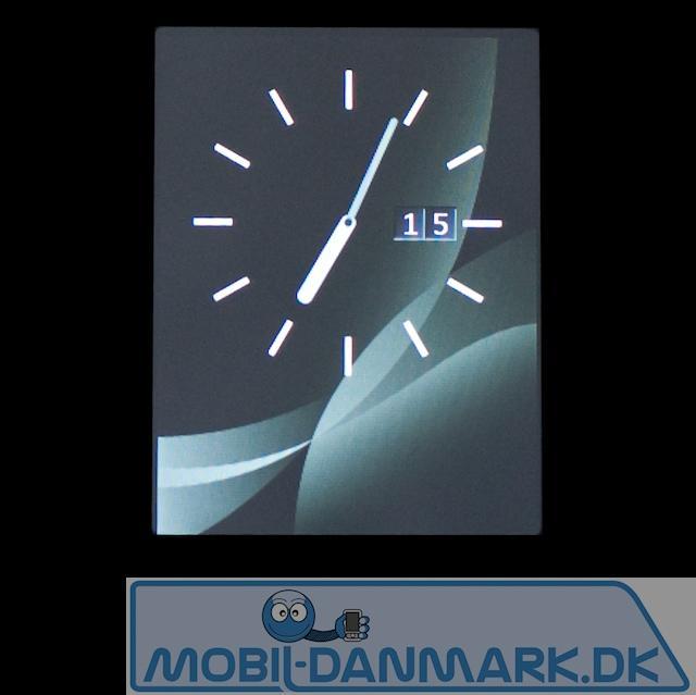 Det fine ur, der kommer frem, når man tapper på skærmen